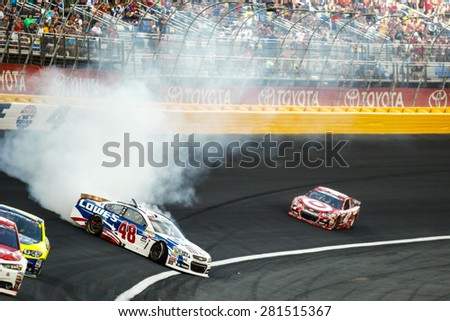 Concord, NC - May 24, 2015:  Jimmie Johnson (48) spins off turn 4 during the Coca-Cola 600 at Charlotte Motor Speedway in Concord, NC. - stock photo