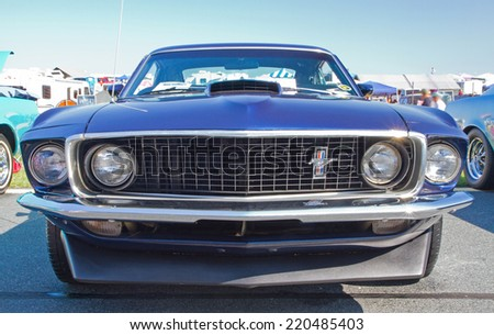 CONCORD, NC -- SEPTEMBER 20, 2014:  A 1969 Ford Mustang automobile on display at the Charlotte AutoFair classic car show held at Charlotte Motor Speedway. - stock photo