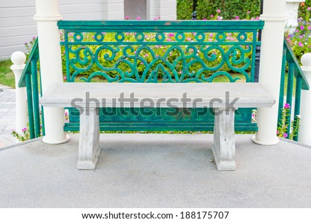 Concrete bench in the pavilion at garden - stock photo