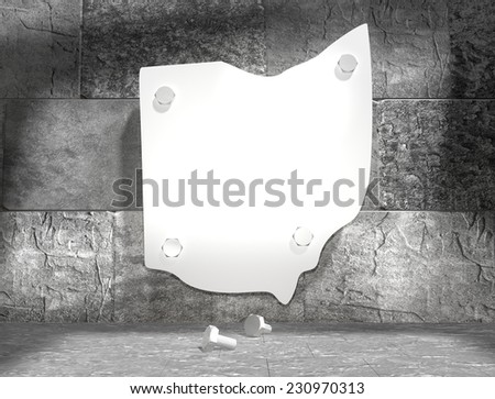 concrete blocks empty room with clear outline ohio state map attached to wall by bolts - stock photo