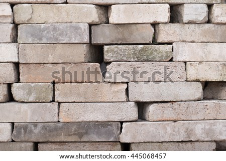 Concrete blocks lined up in a mess. - stock photo