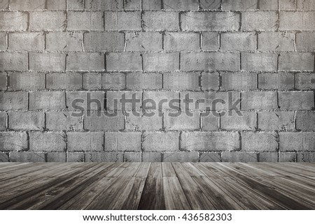concrete cement brick block wall and wooden floor perspective with the light on the top corner - stock photo