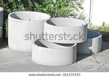 Concrete circle pit block on factory yard - stock photo