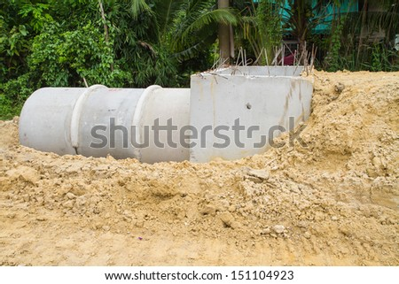 Concrete drainage pipe and manhole under construction  - stock photo