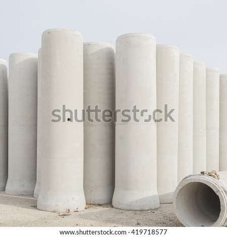 Concrete drainage pipes for industrial building construction. - stock photo