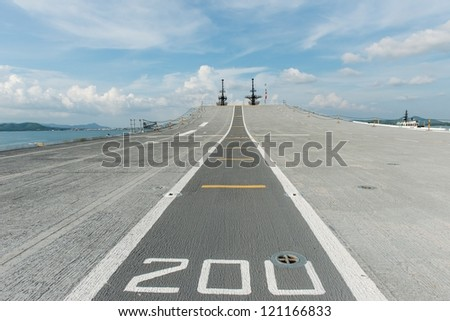 Concrete fighter jet run way of an aircraft carrier, taken on a sunny day in Thailand - stock photo
