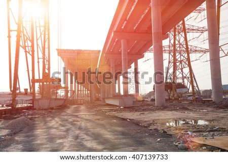 concrete highway under construction against the sun - stock photo