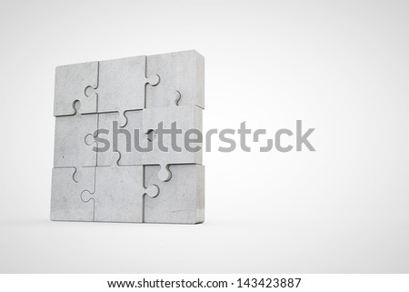 concrete jigsaw puzzle - stock photo
