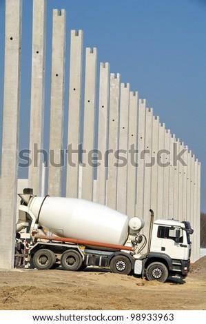 Concrete mixer on construction site - stock photo