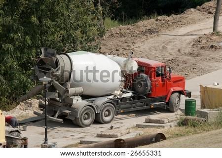 Concrete mixer truck at a construction site - stock photo