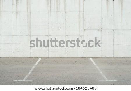 Concrete parking lot wall - stock photo