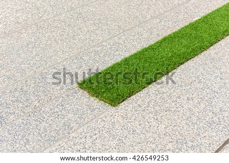 concrete pathway and artificial grass - stock photo