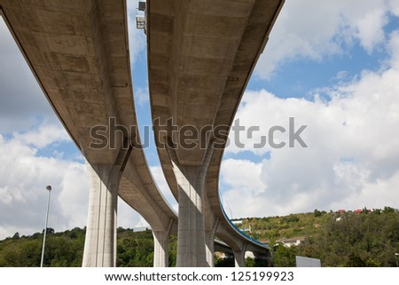 Concrete pilons supporting elevated highway - stock photo