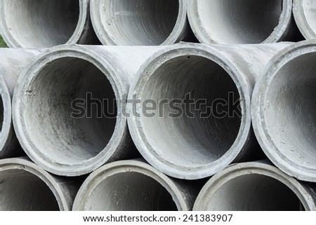 Concrete pipes for industrial and construction - stock photo