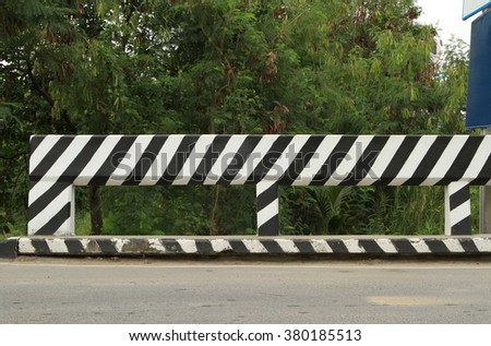 Concrete road fence on the road - stock photo