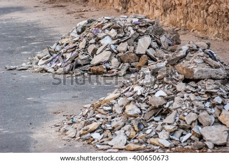 Concrete rubble debris on construction site - stock photo