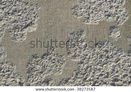 Concrete sidewalk that has been damaged. - stock photo
