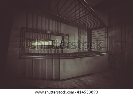 Concrete stairs going down. Vintage colors with dark shadows and light - stock photo