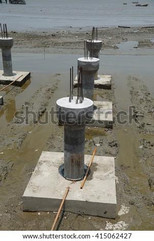 Concrete steel pier construction at the coast - stock photo