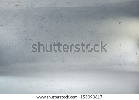 concrete studio room with spotlights - stock photo