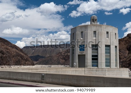 concrete tower with clock at Hoover Dam and cloudy sky - stock photo