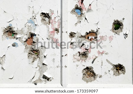 Concrete wall with holes in several places. - stock photo