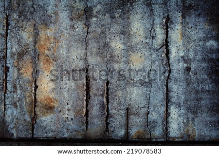 Concrete wall with severe cracks. - stock photo