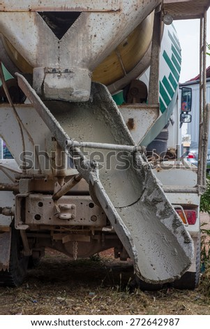 Concrete work, Pouring cement during sidewalk upgrade - stock photo