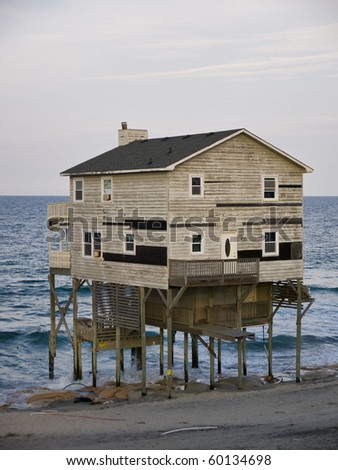 Condemned home along the Atlantic Coast of North Carolina's Outer Banks. - stock photo