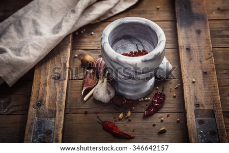 Condiments and Mortar  on a old rustic table - stock photo