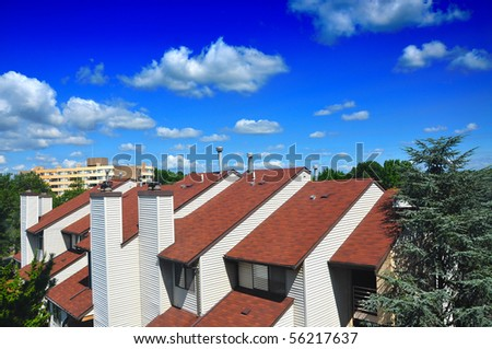 Condo apartments on a beautiful summer day with beautiful cloud over head - stock photo