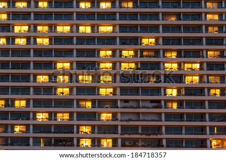Condo Windows At Night Background - stock photo