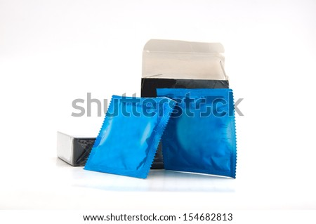 Condom in foil on a white background - stock photo