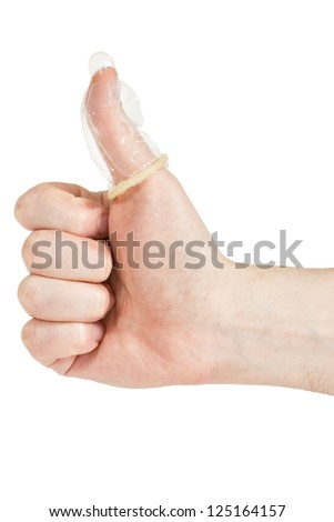 Condom on the finger, isolated on white background - stock photo