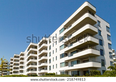 Condominium on a sunny summer day in Hellerup, a suburb of Copenhagen, Denmark. - stock photo