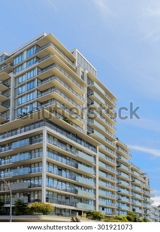 Condominium or apartment building with asymmetrical, stair-step architecture in the city downtown. - stock photo