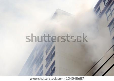 condominium or apartment burning. - stock photo