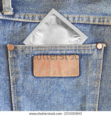 Condoms in the back pocket of jeans - stock photo