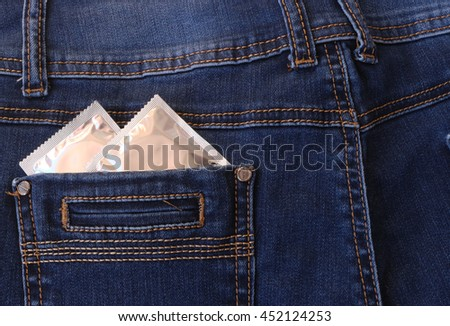 Condoms in the back pocket of jeans.Health, contraception. - stock photo