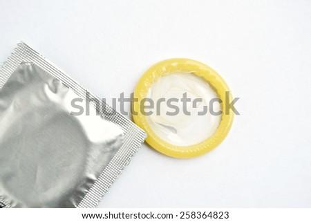 Condoms isolated on white - stock photo