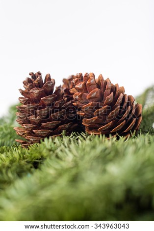 cones on vintage wooden background christmas decoration - stock photo
