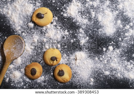 Confectionery background with cookies and kitchenware - stock photo