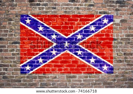 Confederate flag sprayed on brick wall - stock photo