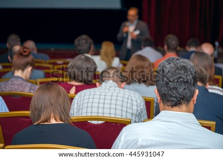 conference hall full audience at the business presentation - stock photo
