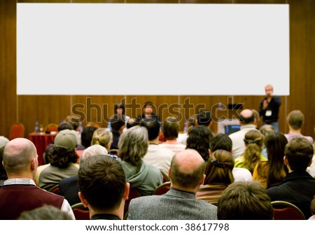 conference hall full of people participating in the business training. - stock photo