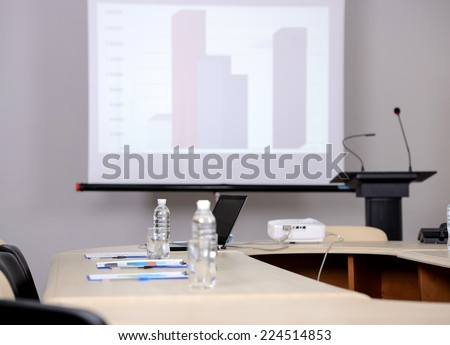Conference hall with tribune and presentation screens - stock photo