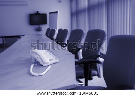 Conference room communication telephone on desk - stock photo
