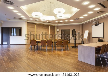 Conference room with modern ceiling lights - stock photo
