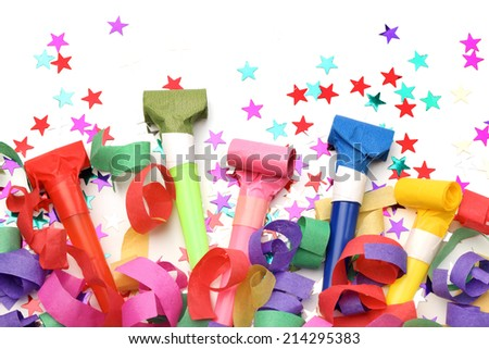 Confetti and whistles on white background - stock photo