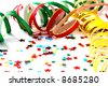Confetti on white background with streamers - stock photo